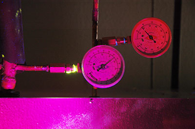 Freon leak exposed under ultra violet light. Freon leak detection experts.